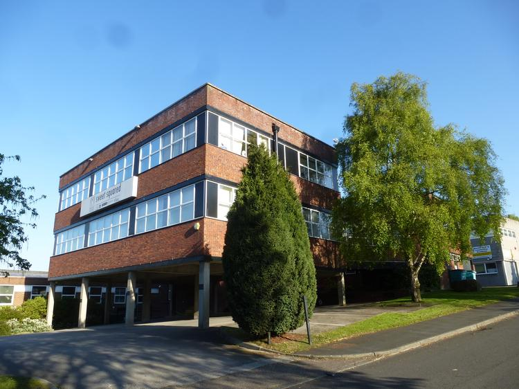 PROMINENT DETACHED OFFICE BUILDING WITH PARKING